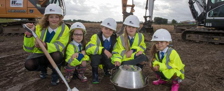 Inchinnan Primary pupils plant the manufacturing time capsule at the Advanced Manufacturing Innovation District Scotland