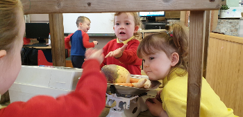 Children at St Margaret's nursery in Johnstone pretend to work at a greengrocer