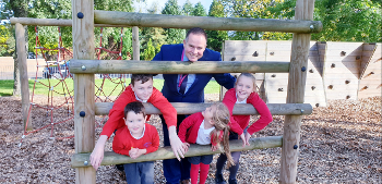 Langbank Primary School Headteacher Simon Cundy with pupils Evan, Freya, Issac and Georgia