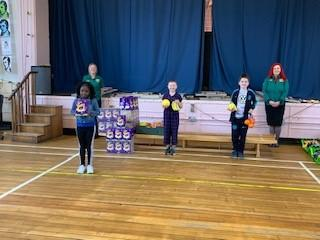 Children with Easter eggs and fruit donated by Morrisons
