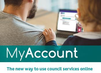 image showing man and child looking at MyAccount at home