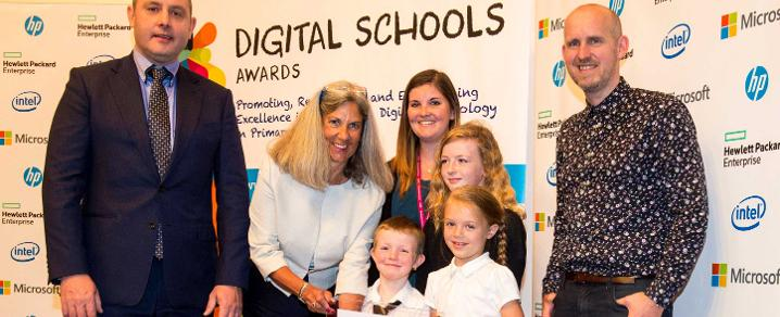 Pupils from Cochrane Castle accept their Digital Schools Award