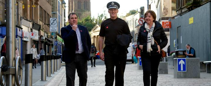 Chief Superintendent Gordon Crossan with Council Leader Iain Nicolson and Councillor Marie McGurk on Paisley High Street