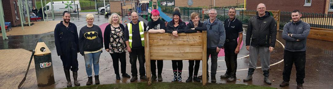 Parents of Riverbrae School and community police lay turf donated by Scotlawn