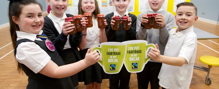Schoolkids with Fairtrade tea pack