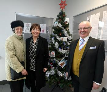 Councillor Marie McGurk in the new extension at Provost Close with residents Ann MacNeill and Bob Duffy