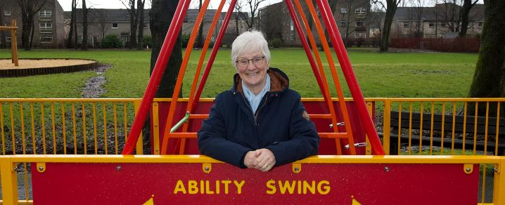 Cllr McEwan at wheelchair accessible swing