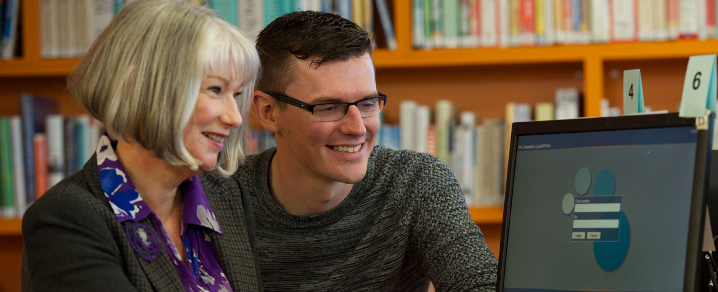 Digiteer Maggie McAlistair and Advice Works adviser Kevin Campbell at Johnstone library