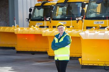 Cllr McEwan with the gritting vehicles