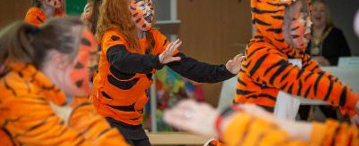 Riverbrae School pupils performing a ROARing show in celebration of the school's first birthday.