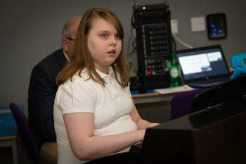 Riverbrae School pupil playing the piano