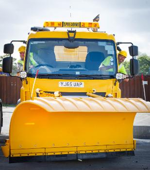 Drivers Eric Phillips and John Clark at the wheel of a gritter