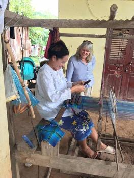 Eve Broadis with an artisan in Cambodia