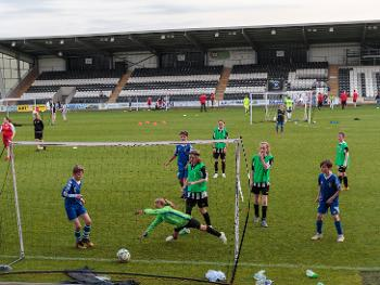 A youngster hits the back of the net