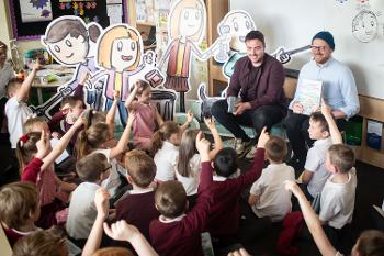 Ross and Neil read to Kirklandneuk primary pupils